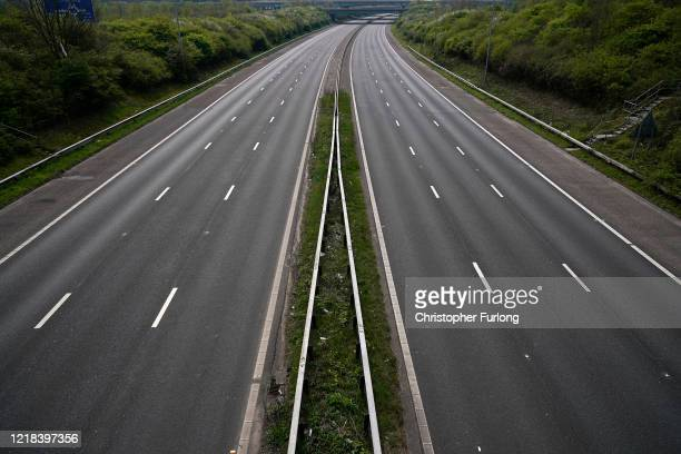 Midafternoon the M6 motorway is deserted as people heed the official advice and stay home on Easter Sunday traditionally a busy weekend for day...