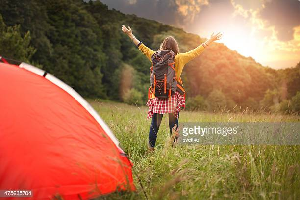 Midage woman camping in the forest.