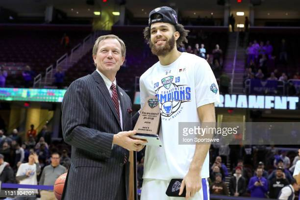MidAmerican Conference Commissioner Dr Jon A Steinbrecher presents the tournament MVP award to Buffalo Bulls guard Jeremy Harris following the MAC...