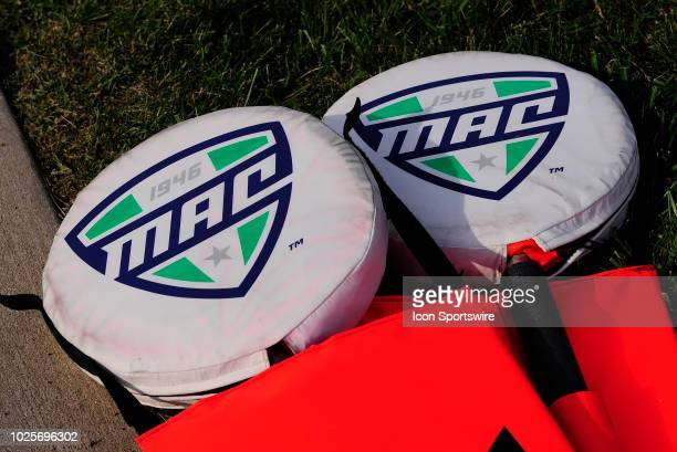 MidAmerican Conference logos are seen on the top of the sideline signal poles before the start of the college football game between the Central...
