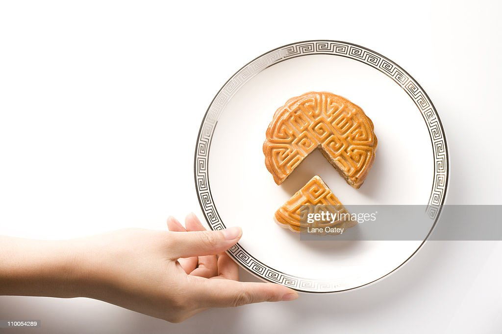 Mid-Autumn Festival Moon Cake, Cut and Presented on Plate : Stock Photo