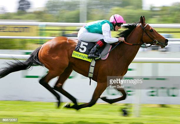 Midday ridden by Tom Queally on his way to winning The totesportcasinocom Oaks Trial Stakes race during the race meeting at Lingfield Park on May 09...
