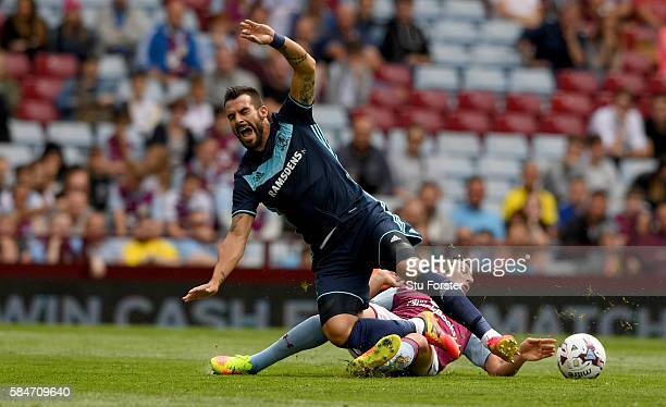Middesbrough forward Alvaro Negredo is fouled by Tommy Elphick of Villa during the pre season friendly between Aston Villa and Middlesbrough at Villa...
