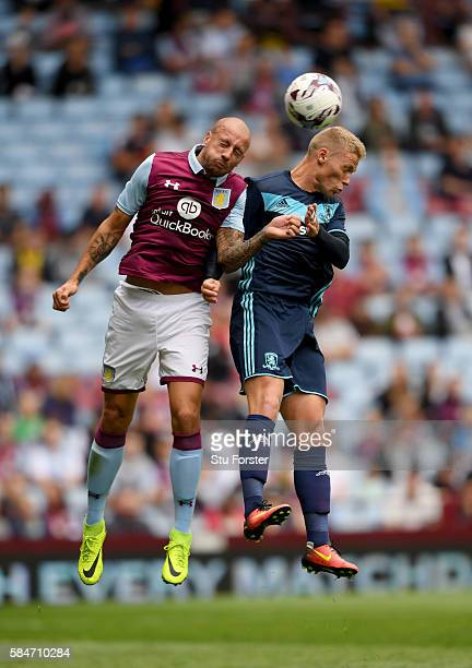 Middesbrough forward Viktor Fischer is challenged by Alan Hutton of Villa during the pre season friendly between Aston Villa and Middlesbrough at...