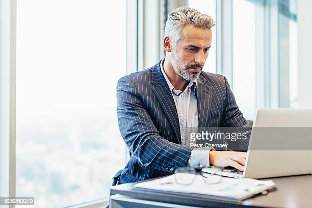 Middle age businessman in the office