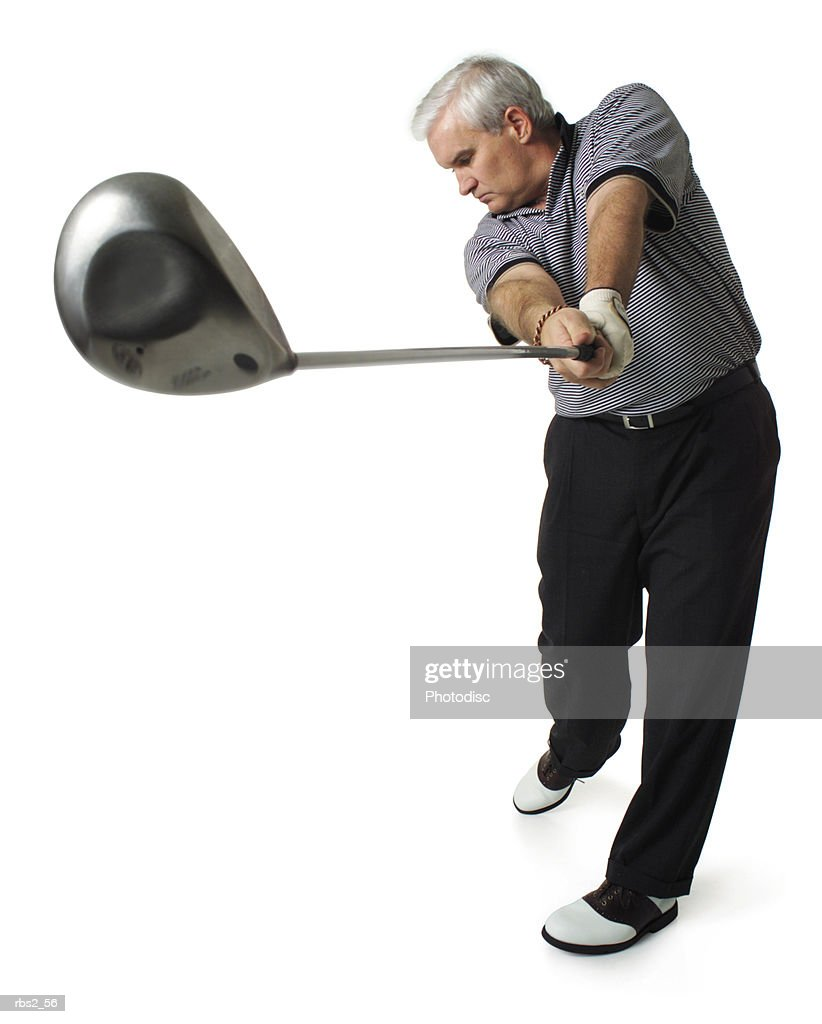 middle age caucasian man wears a gray golf shirt swings club after hit head of club close to camera : Foto de stock