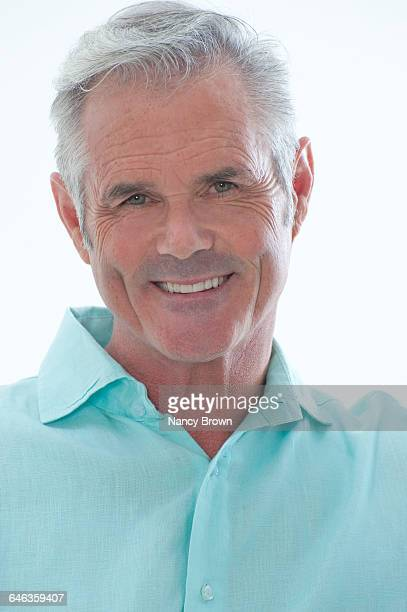 Middle Age Man Head Shot Smiling at Camera on Whit