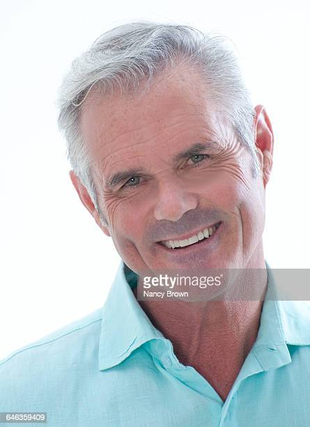 Middle Age Man Head Shot Smiling Camera on White.