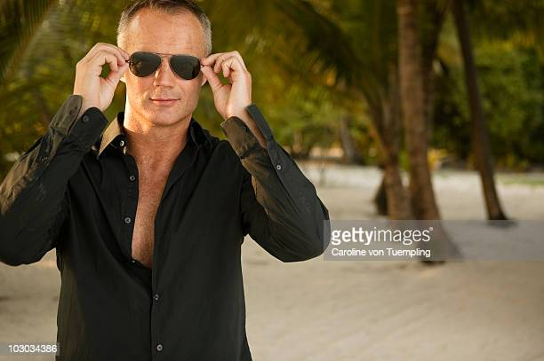 Middle age man in sunglasses at island resort