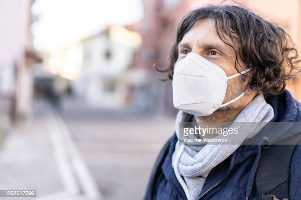 middle age man wearing in eu obligatory ffp2/kn95/n95/ protective mask - centers for disease control and prevention stock pictures, royalty-free photos & images