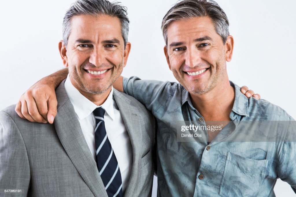 Middle age twins, one smart, one casual : Stock Photo