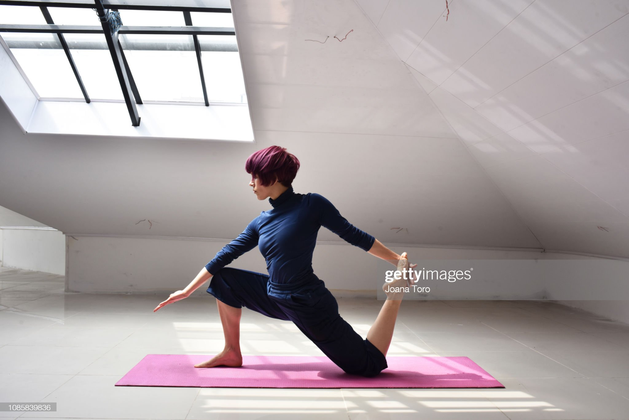 middle age woman practicing yoga : Stock Photo