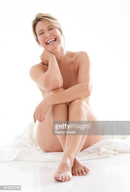 Middle age woman sitting nude