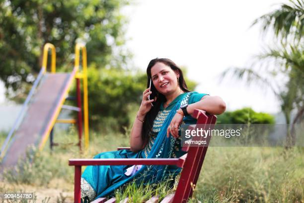 Middle age woman talking on mobile phone