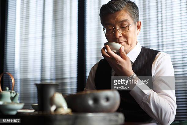 middle aged and old men drink tea - 上流社会 ストックフォトと画像