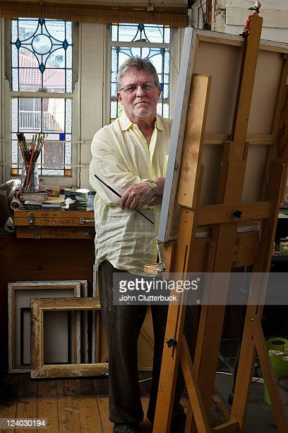 Middle aged artist in his studio