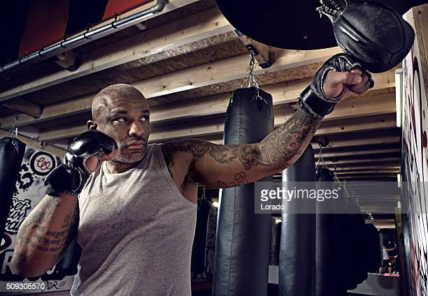 Middle aged black man at an urban styled boxing gym