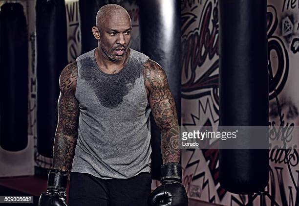 middle aged black man at an urban styled boxing gym - most handsome black men stock photos and pictures