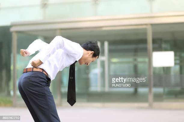 Middle aged businessman suffering from back pain