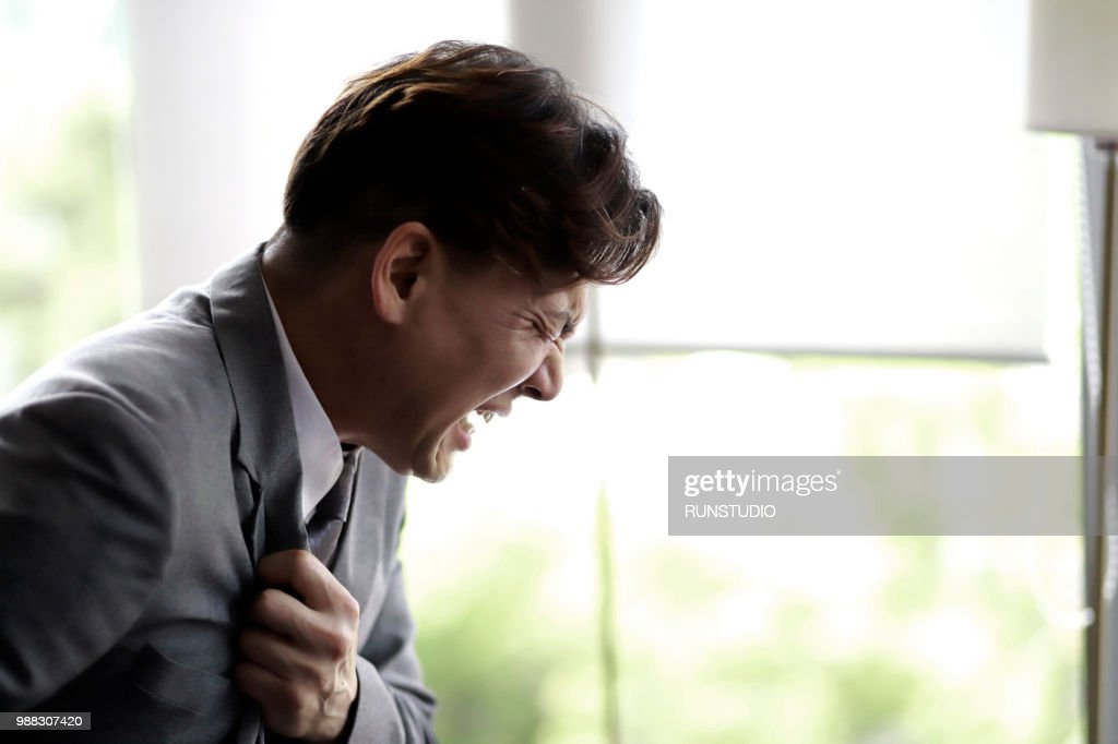 Middle aged businessman suffering from chest pain : Stock Photo