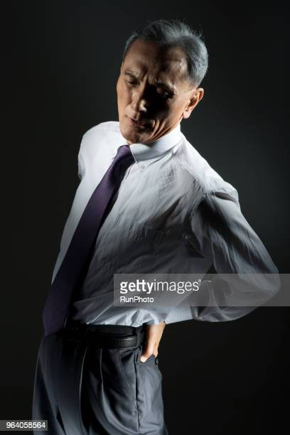 Middle aged businessman with back pain