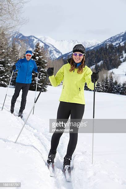 Middle Aged Couple Back Country Nordic Skiing