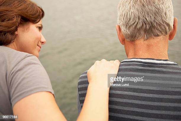 Middle aged couple, hand on shoulder