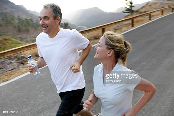 middle aged couple out jogging - atlantic islands stock pictures, royalty-free photos & images