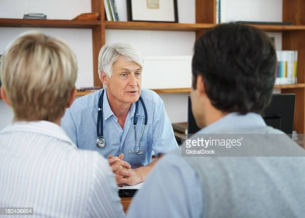 Middle aged couple visiting a doctor for checkup