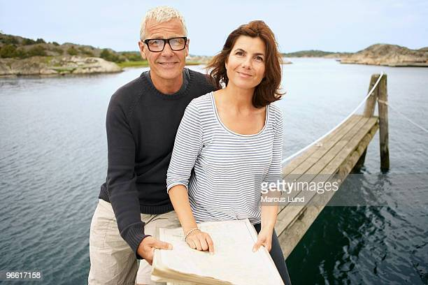 Middle aged couple with map