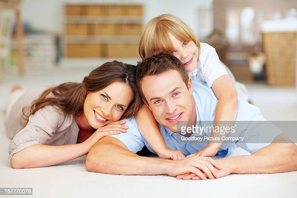 Middle aged couple with their son spending time together