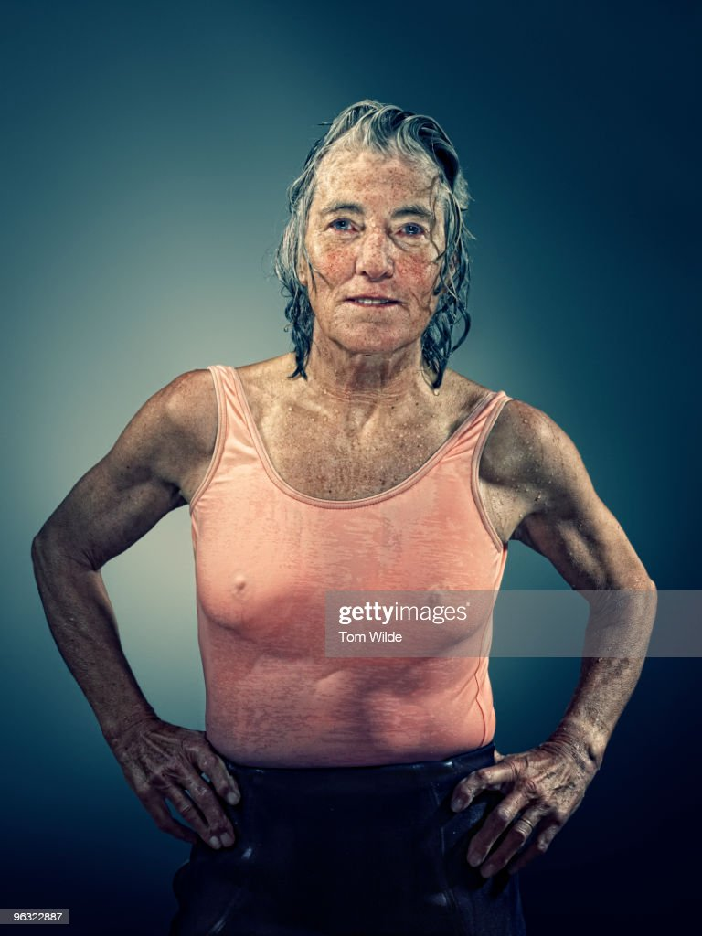 Middle aged female surfer with wet hair and body : Stock Photo