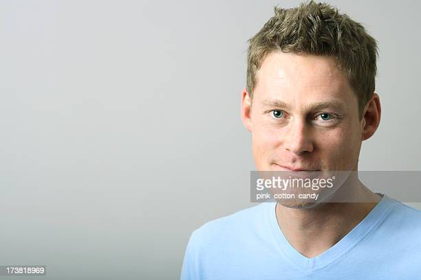 A middle aged male smiling at the camera