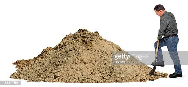 middle aged man digging in pile of dirt using shovel - digging stock pictures, royalty-free photos & images