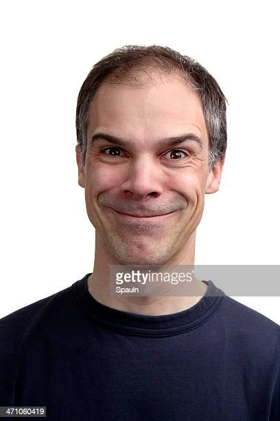 Middle aged man grinning from ear to ear