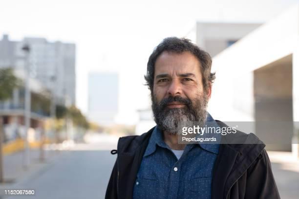 middle aged man in a city street - homem 50 anos imagens e fotografias de stock
