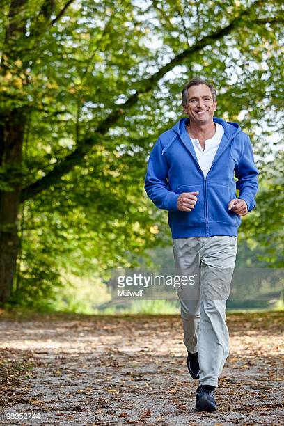 Middle aged man jogging