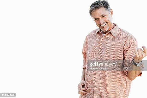 Middle aged man playing air guitar