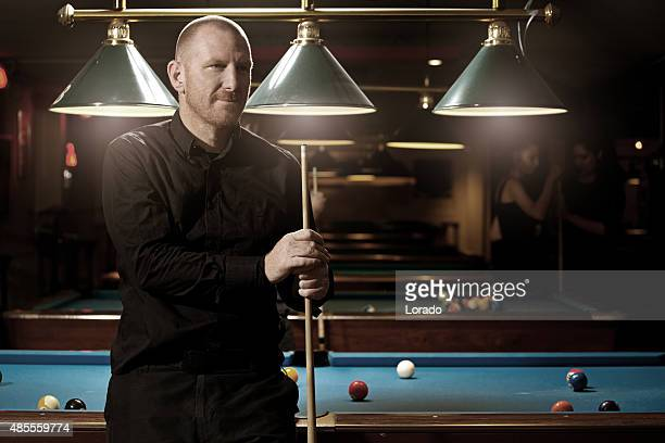 Middle aged man playing pool