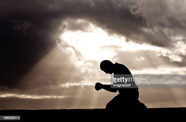 middle aged man prayer silhouette - forgiveness stock pictures, royalty-free photos & images