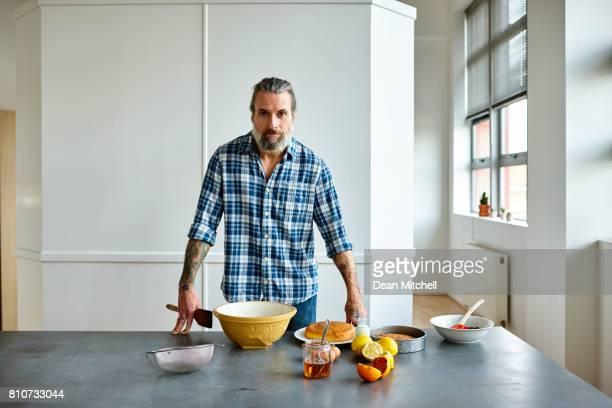 Middle aged man preparing to bake