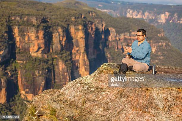 Middle Aged Man Resting While Bushwalking in Blue Mountains Australia