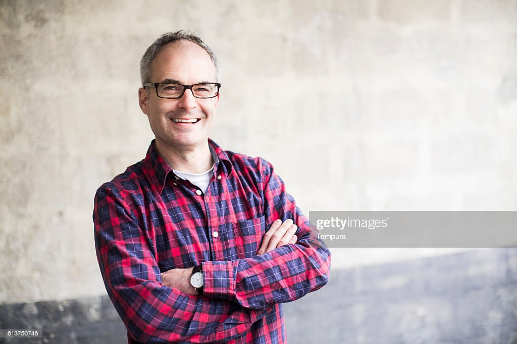 Middle aged man smiling and looking at camera. : Stock Photo