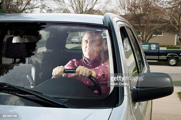 Middle aged man thinking in car