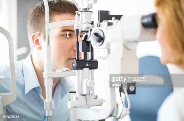 Middle aged man visiting optician.