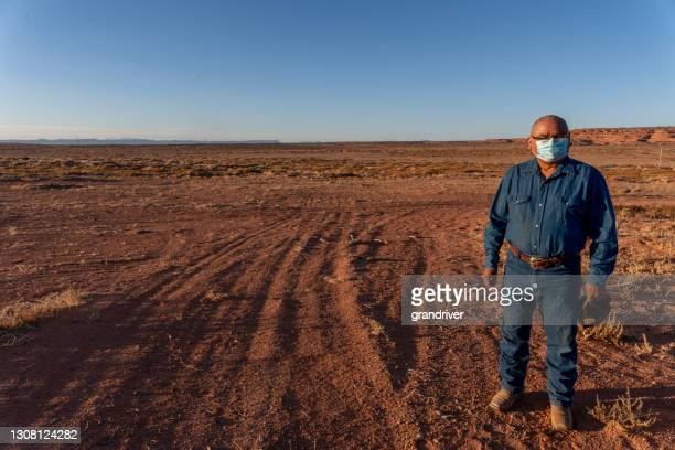 middle aged navajo man on his rural property in monument valley utah near arizona during the covid-19 corona virus pandemic - cherokee culture stock pictures, royalty-free photos & images