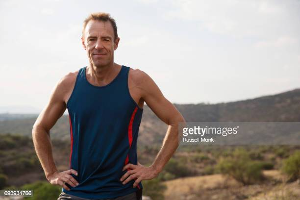 a middle aged runner - hand on hip stock pictures, royalty-free photos & images