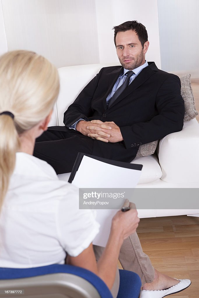 middle aged smart male executive interviewing : Bildbanksbilder