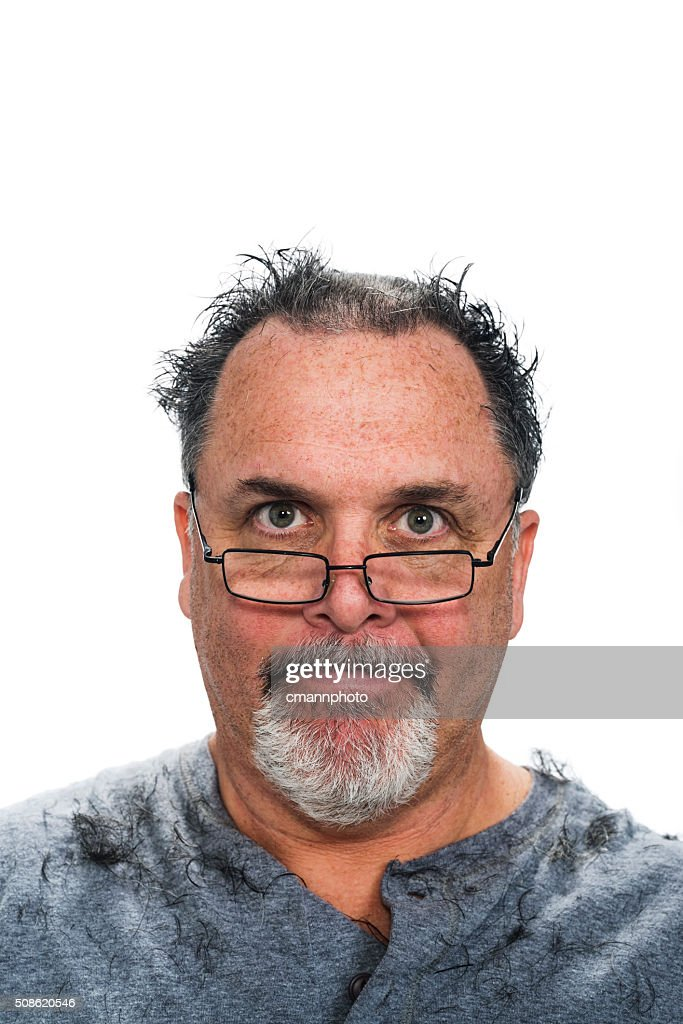 Middle aged white man checking his hair cut : Stock Photo