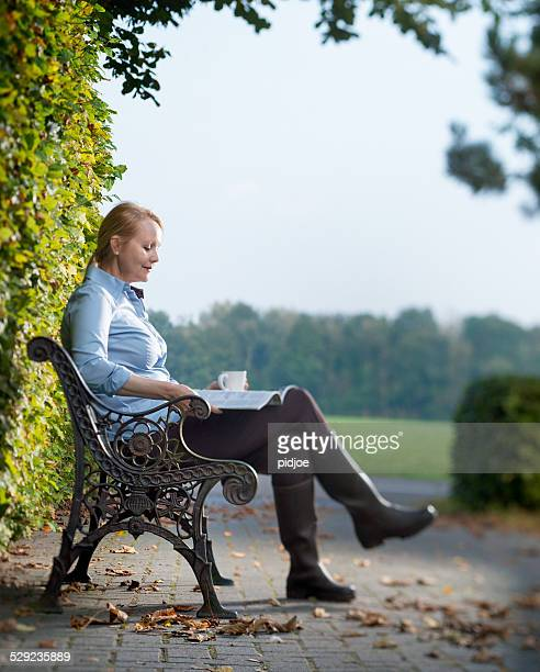 Middle aged woman enjoying the autumn sun